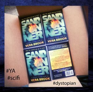 Box full of print copies of Sand Runner by Vera Brook, now out in paperback and ebook